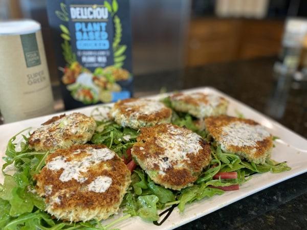 Image ofPlant Based Crab Cakes w/ Lemon-Tarragon Aioli on a Simple Arugula Salad