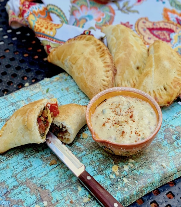 Image of Sausage, Peppers & Onion Empanadas with Pale Ale Beer Sauce