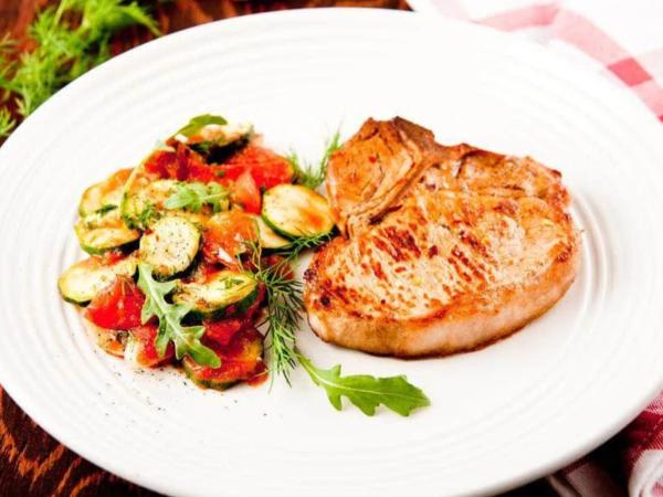 Image of Garlic & Rosemary Boneless Pork Chops With Arugula Salad
