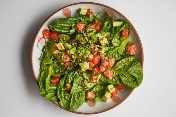 Image ofSalmon Poke on Greens with Wasabi Peas