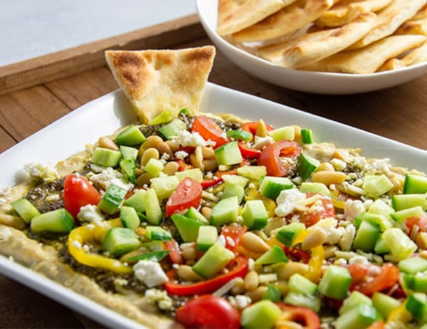 Image of Layered Hatch Chile Hummus Dip with Toasted Pita Chips