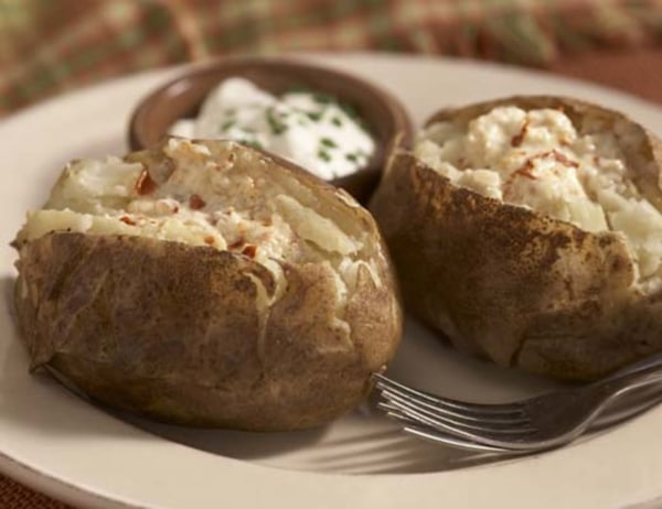 Image ofBaked Potatoes with Pepper-Flake Garlic Butter and Sour Cream