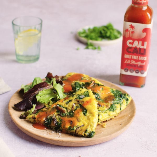 Image of WILD MUSHROOM AND SPINACH OMELETTE with Sriracha