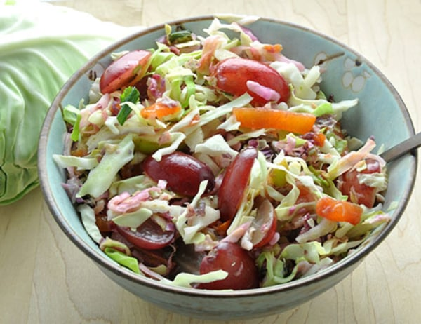 Image of Cabbage Slaw with Butterscotch™ Pears, Persimmon, Radish & Christmas Crunch® Grapes