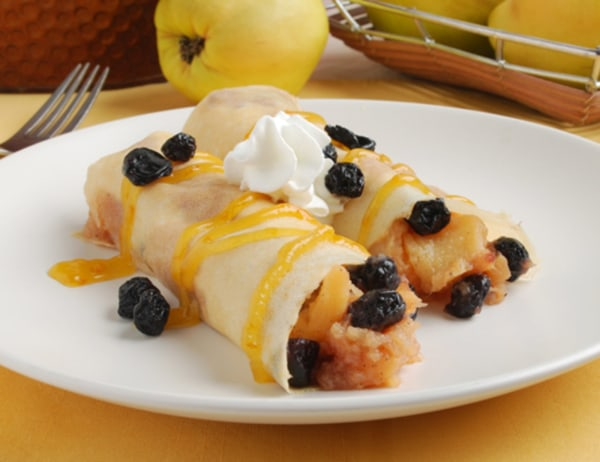 Image ofQuince Butter Filled Crepes with Pixie Tangerine Sauce