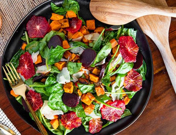 Image ofCinnamon Persimmon and Roasted Beet Autumn Salad with Blood Orange Vinaigrette