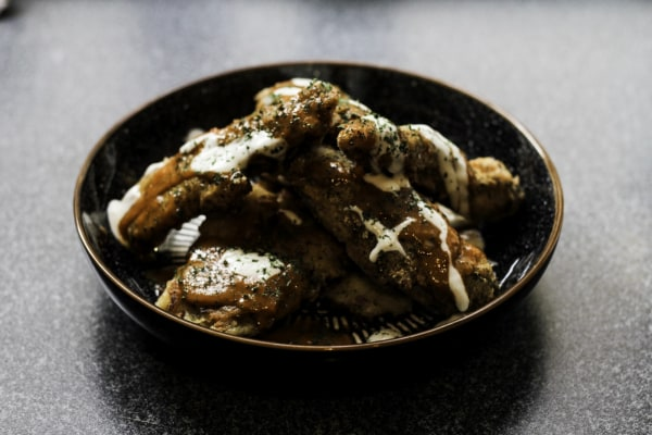 chicken strips and buffalo sauce