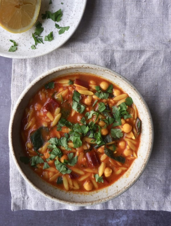 Image of Moroccan Spiced Chickpea, Chard + Orzo Stew