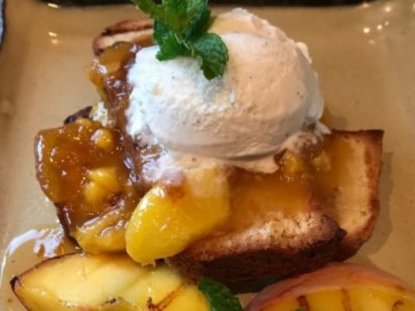 Image ofGrilled Pound Cake with Warm Peach Coulis & Ice Cream