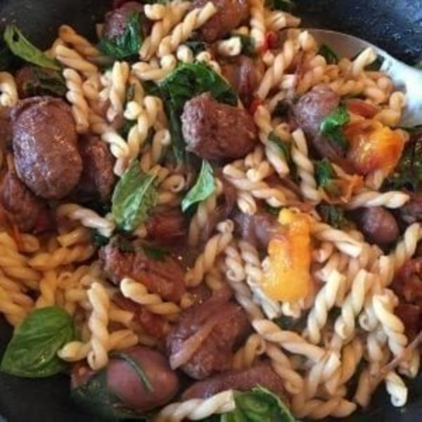 Image ofGemelli With Sweet Italian Sausage, Arugula & Beet Greens
