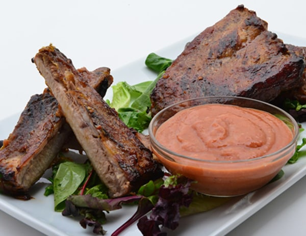 Image ofGrilled Rack of Ribs with Cactus Pear-Mango BBQ Sauce