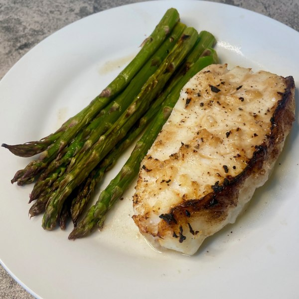 Image of roasted sea bass with asparagus and mojo (citrus garlic sauce)