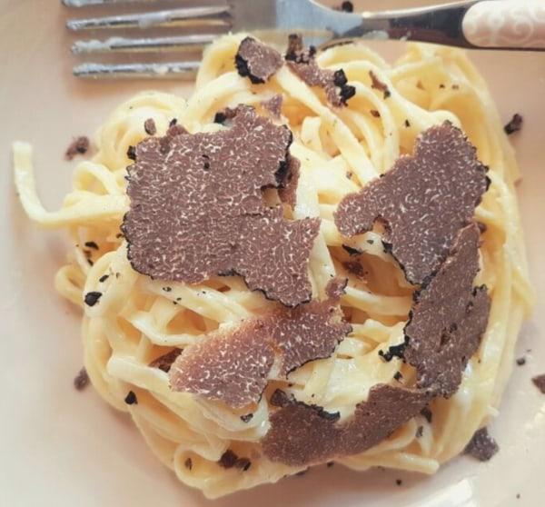 Image ofTagliolini with taleggio and black truffle