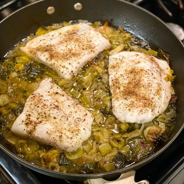 Image of Ayala spice slow roasted fluke with schmaltz, leeks, and celery