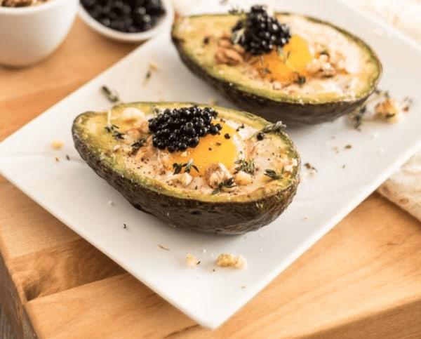 Image ofEggs and Caviar in Avocado Boat
