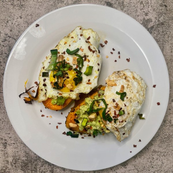 Image of loaded sweet potatoes with guac an eggs