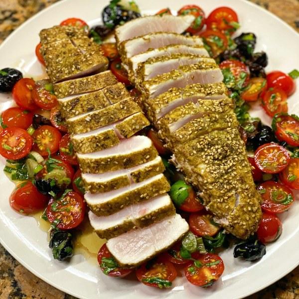 Image ofZa'atar Seared Hamachi over Tomato & Olive Salad