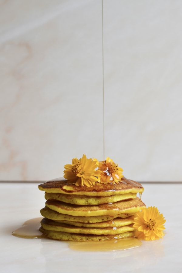 Image ofTurmeric Pancakes Topped with Maple Syrup