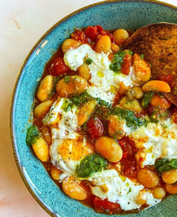 Image ofBaked Tomato Butter Beans with Cold Buratta + Pesto