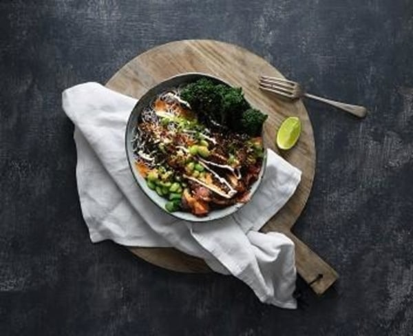 Image ofSalmon and seaweed warm poke bowl with spicy peanut sauce