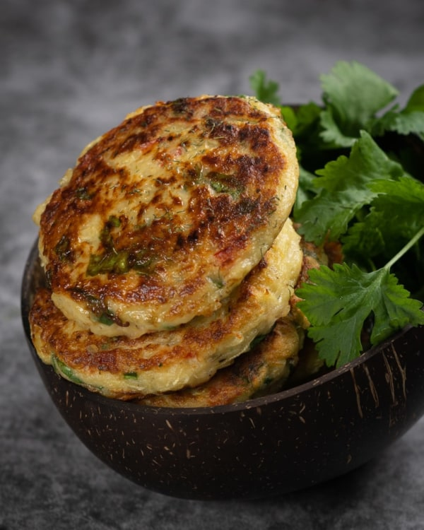 Image ofSpicy courgette fritters with creamy sweet potato mash and wilted spinach