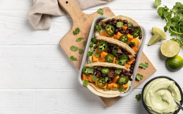 Image of Sweet Potato and Black Bean Tacos with Avocado Cream