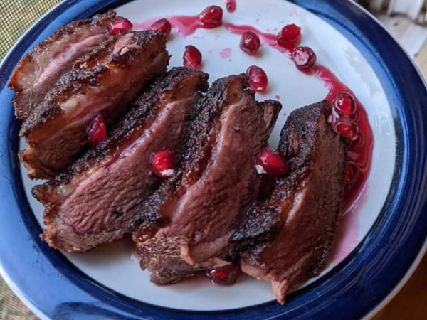 Image of Duck Breast with Cranberry-Pomegranate Reduction
