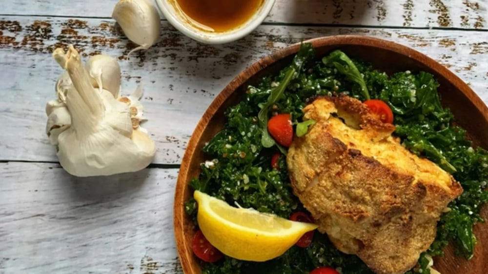 almond flour crusted cod over kale