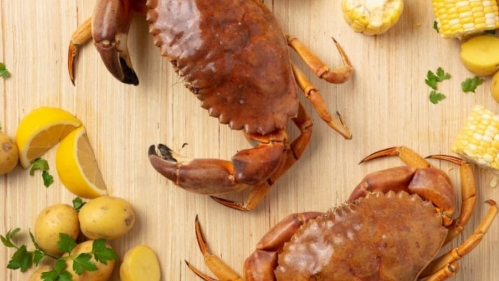 Yellow rock crab boil with corn and potatoes