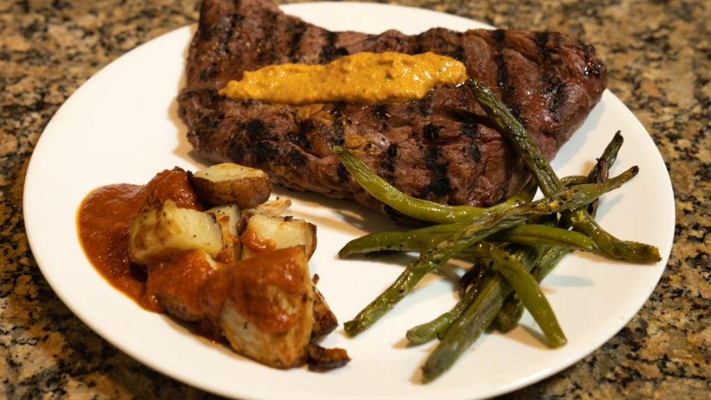 Gilled bison ribeye with romesco sauce
