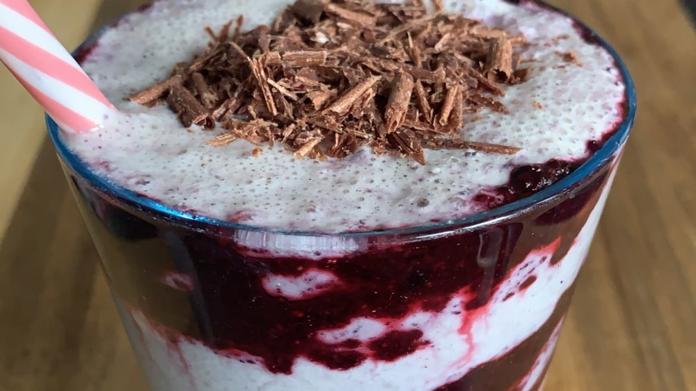 Top with raw chocolate flakes for an extra special shake
