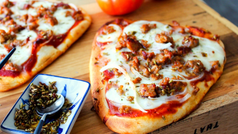 Image of Naan Pizza with Italian Sausage, Toasted Fennel, & Onions