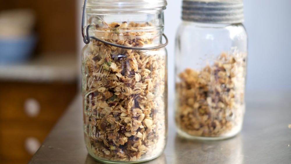 Nibby & Nutty Granola stored in glass jars and ready to be enjoyed.