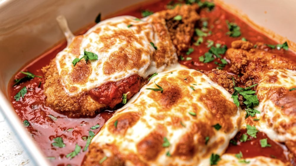 Tomato basil marinara tops Keto Chicken Parmesan.
