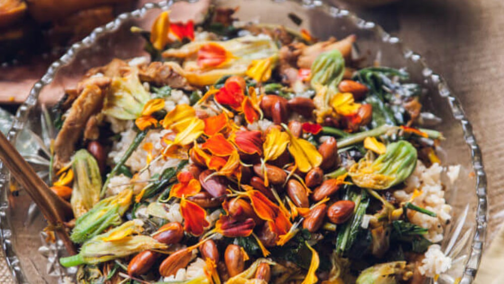 Image of Warm Rice & Weed Salad with Toasted Almonds, Black Cumin, and Edible Flowers