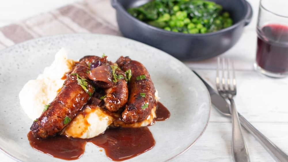 Image ofSausages, Creamy Mashed Potato with Red Wine & Onion Sauce Recipe