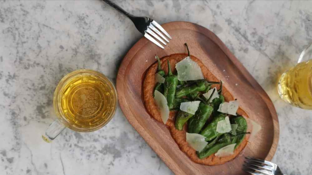 Image of Padron Peppers with Romesco Sauce & Manchego cheese.