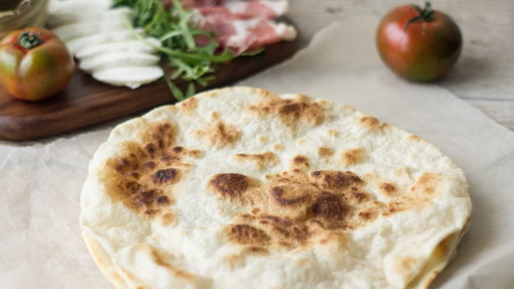 Image ofItalian Flat Bread with Rocket, Mozzarella, Basil and Tomato