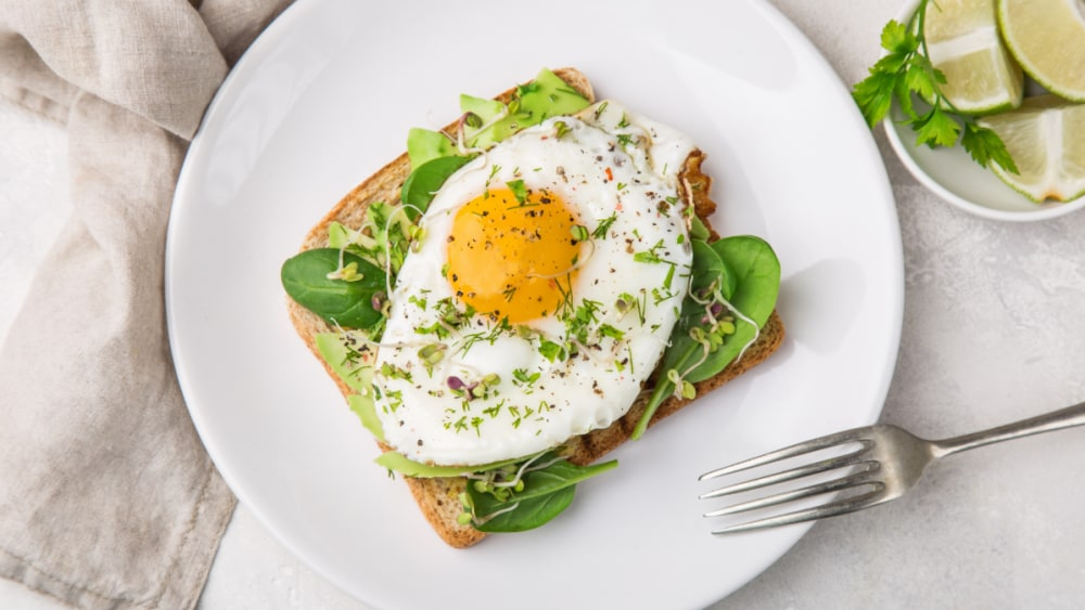 Image of Avocado Sourdough Toast with a Fried Egg and Herbs