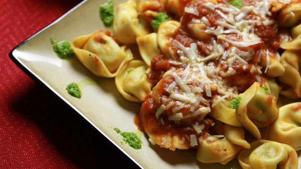 Image of Fresh Tortellini w/ Pomodoro Sauce and Banging Basil Pesto