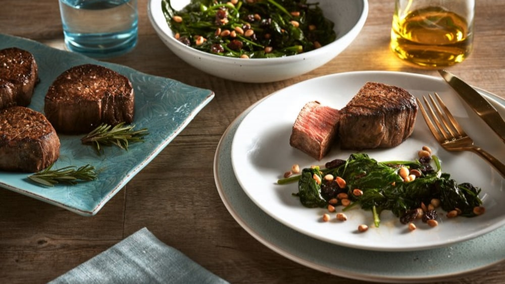 Image of Wagyu Tenderloin reverse-seared with Spinach, Pine nuts and Raisins.