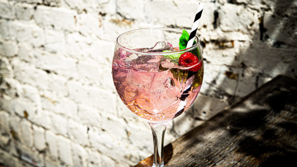 Image of Ultimate Pink Gin Cocktail with Elderflower, Raspberries & Fresh Basil