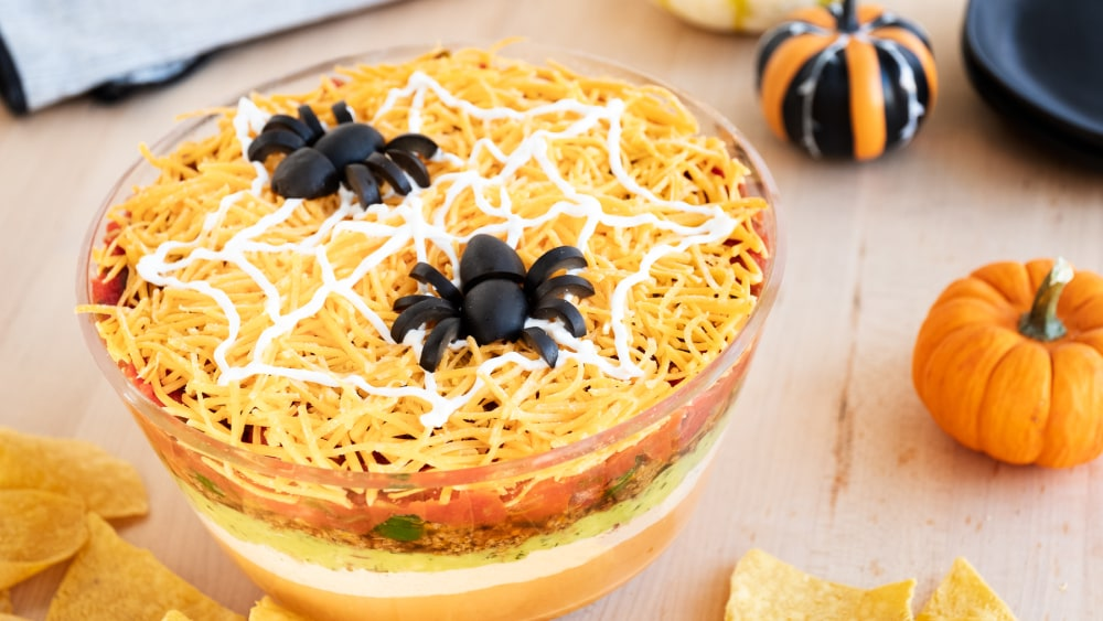 Halloween Taco Dip with black olive spiders