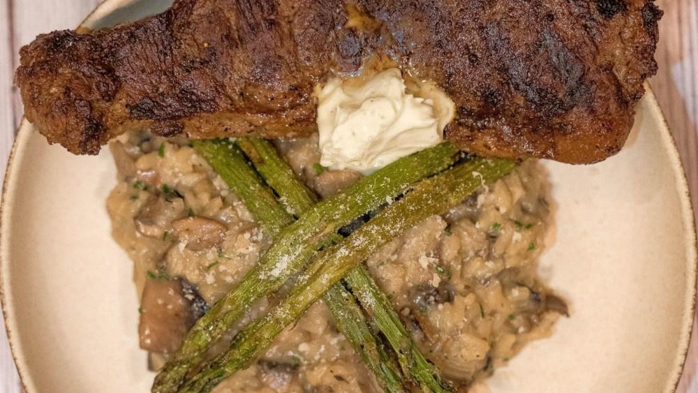 Image of Bison Strip Steak with Mushroom Risotto and Gorgonzola Cream Sauce
