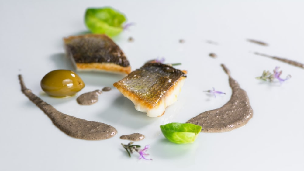 Image of White fish fillet in Truffle and olive sauce