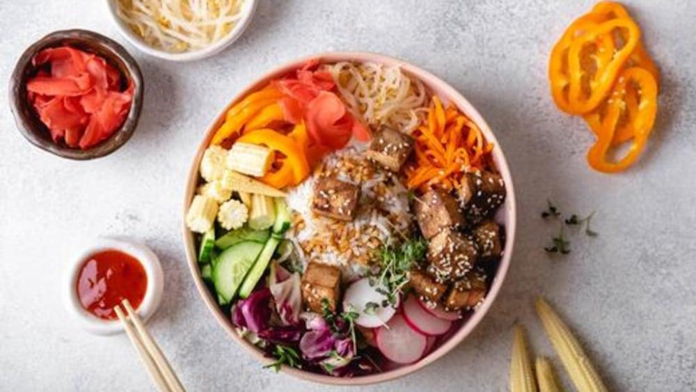 Image of Vegan Bibimbap Bowl: Crispy Tofu, Cremini Mushrooms, and Tangy Gochujang