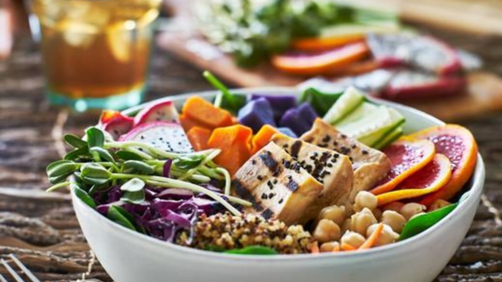 Image of Vegan Buddha Bowl: Tofu Quinoa Bowl with Roasted Vegetables