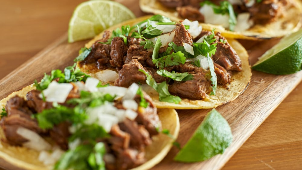 Image of Carne Asada Tacos Recipe: Mexican Steak Marinade with Fresh Guacamole on Corn Tortillas