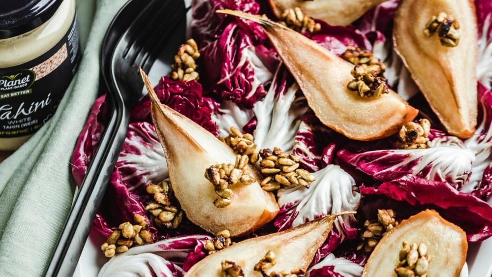 Image of Roasted pear radicchio salad with tahini dressing and sunflower seeds savoury granola