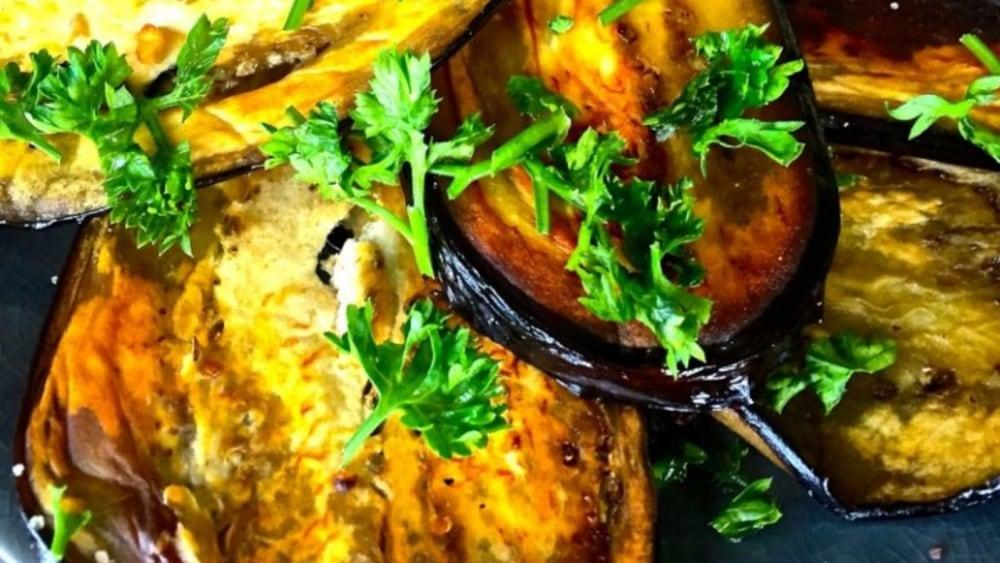 Image of Aubergine slices with tahini cumin sauce